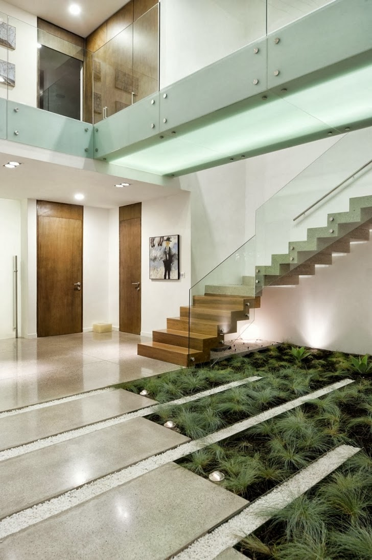 Lobby with stairs in Modern dream home by Paz Arquitectura