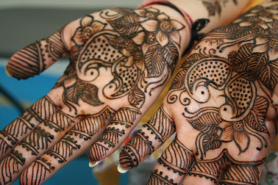 Flower pattern drawn on both palm with Mehandi.