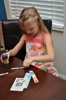 a before kindergarten child creating Reading Wands