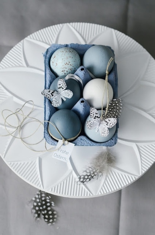 romantic blue colors Easter eggs with paper butterflies