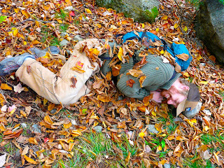 Hiker covered in leaves
