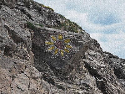 Flower painting on cliffs at Cornwall