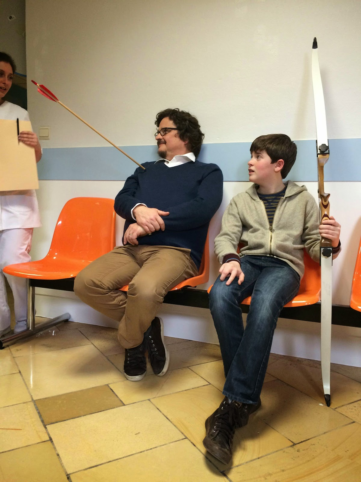 boy shoots arrow into fathers shoulder funny