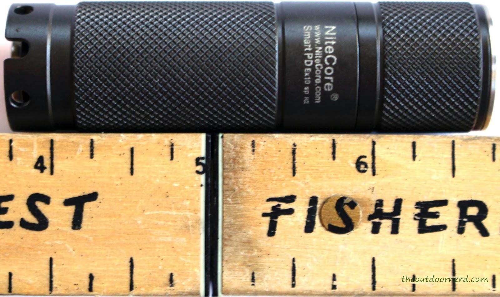 Nitecore Ex10 1xCR123A Flashlight Next To Ruler