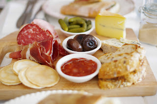 Selection of cheese, cured meats and crackers