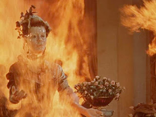 Wax sculpture on fire in House of Wax