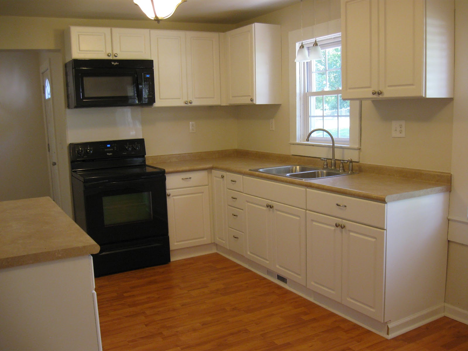 paint and white trim paint to the kitchen as wells as the laminate