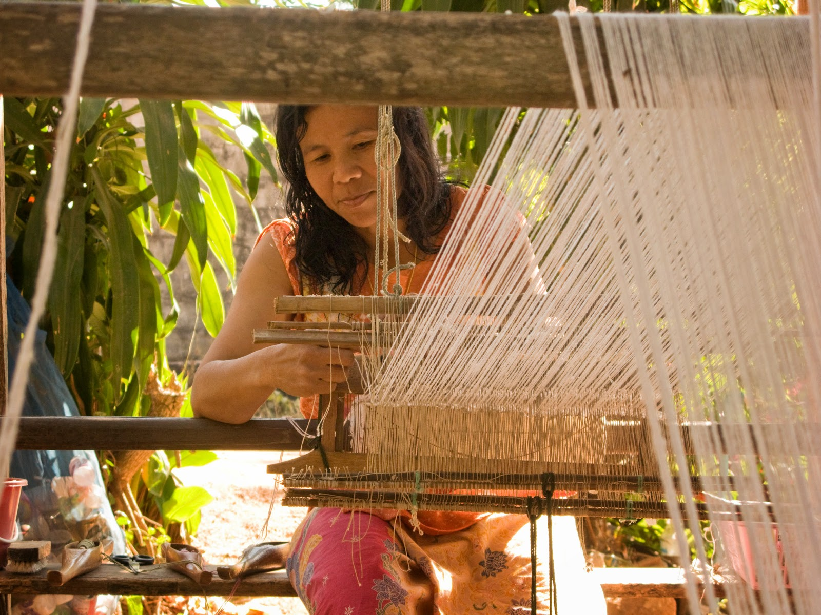Benjaw learned to weave when she was 10, like most cotton and silk weavers in Thailand and Laos. She weaves when she has time, after caring for her 3 children and running a small village shop in her home.