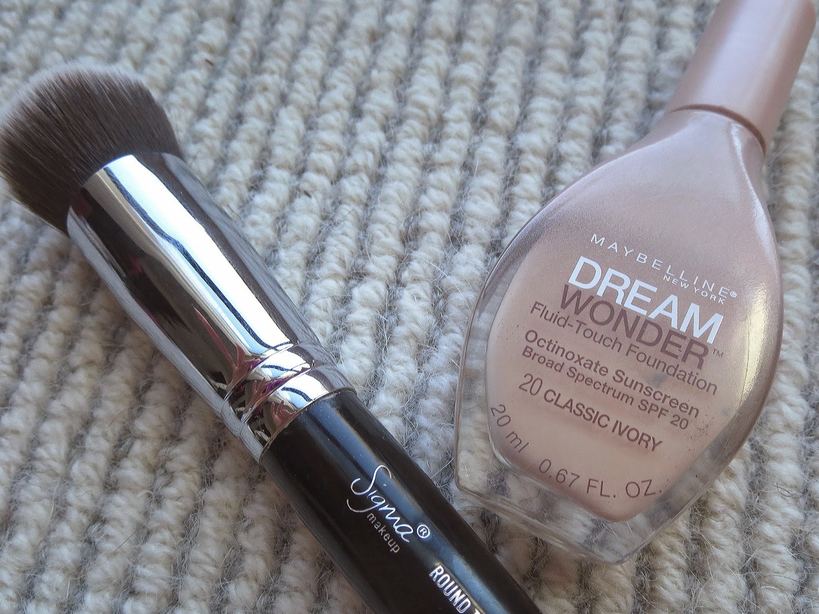 a picture of Maybelline Dream Wonder Foundation with Sigma F82 brush