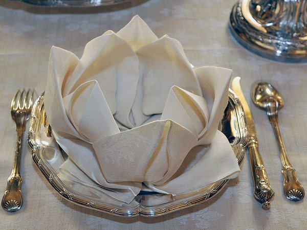 Lotus Serviette Folding : are very ornate but those folded napkins are just amazing