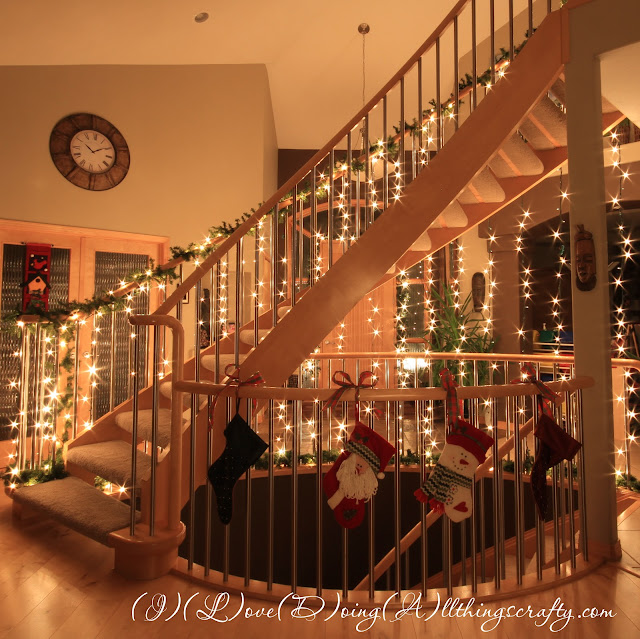 I love doing all things crafty diy wall staircase of lights for Hang stockings staircase