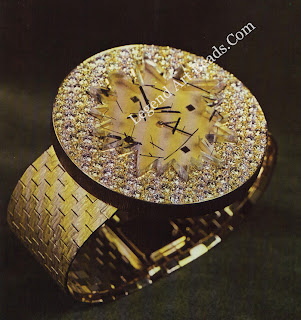 """Watch by Andrew Grima, with a jagged """"glass"""" of tourmeline quartz and pave set with diamonds"""