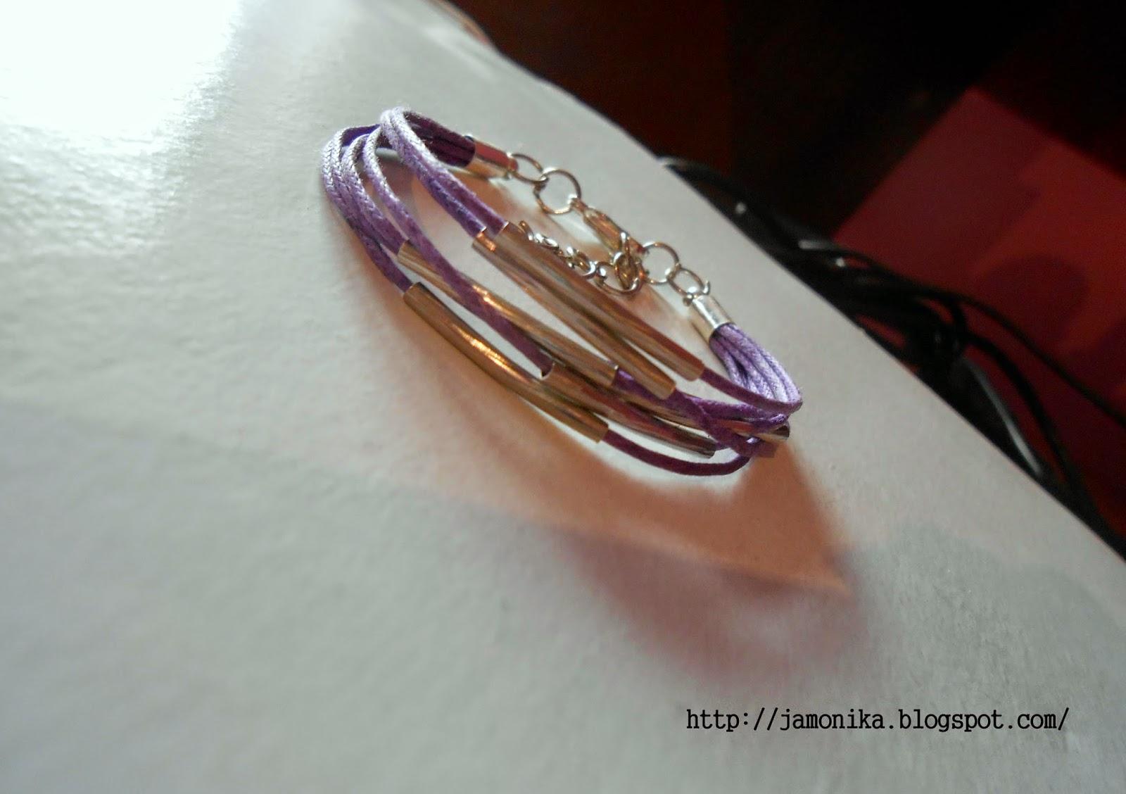 Fioletowa bransoletka z metalowymi rurkami