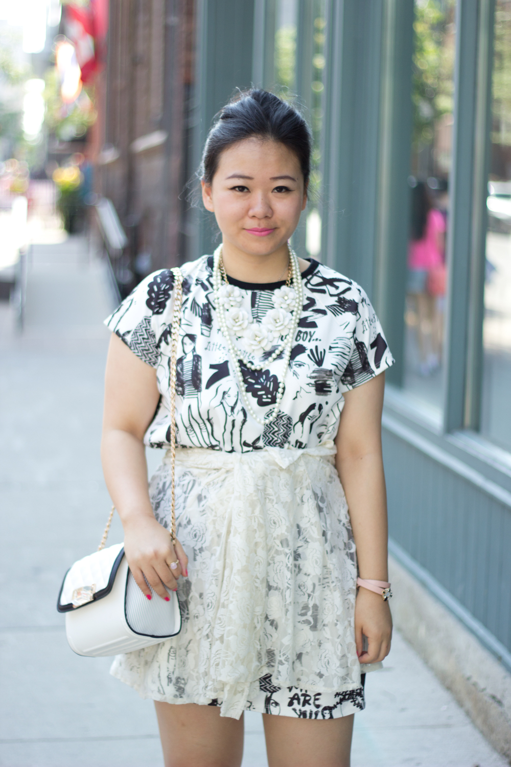 black-and-white-graphic-dress, statement-necklaces, lace-cardigan-as-a-shkirt