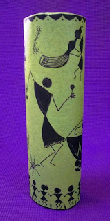 warli art on a vase. warli motifs in celebration mood