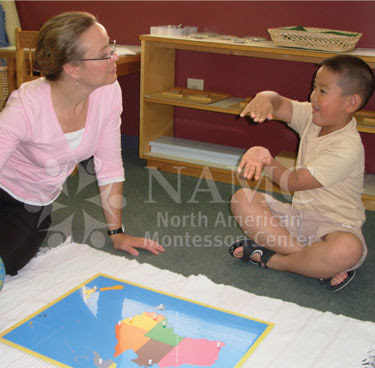 NAMC montessori teacher with student world map puzzle worries as new teacher