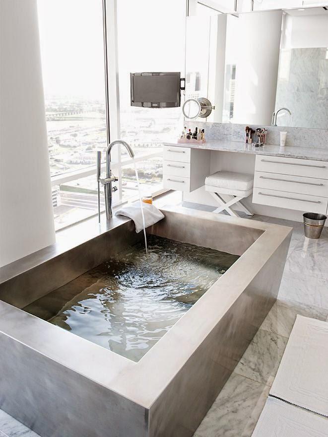Baños Con Tina De Cemento:Con un baño minimalista podrás conseguir crear un pequeño lugar de