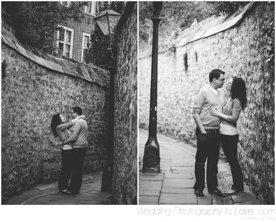 romantic photo of couple kissing under a streetlamp on cobbled street