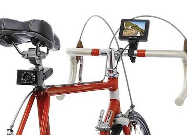 A rear view camera for your bike. Just strap the camera firmly under the seat and attach the display to the handlebars. Kind of looks like a GPS navigation system, but in reality you get a view of what's behind you. Yep, it replaces those silly bicycle rearview mirrors, but you might still want to turn your head and get a good look in critical situations.