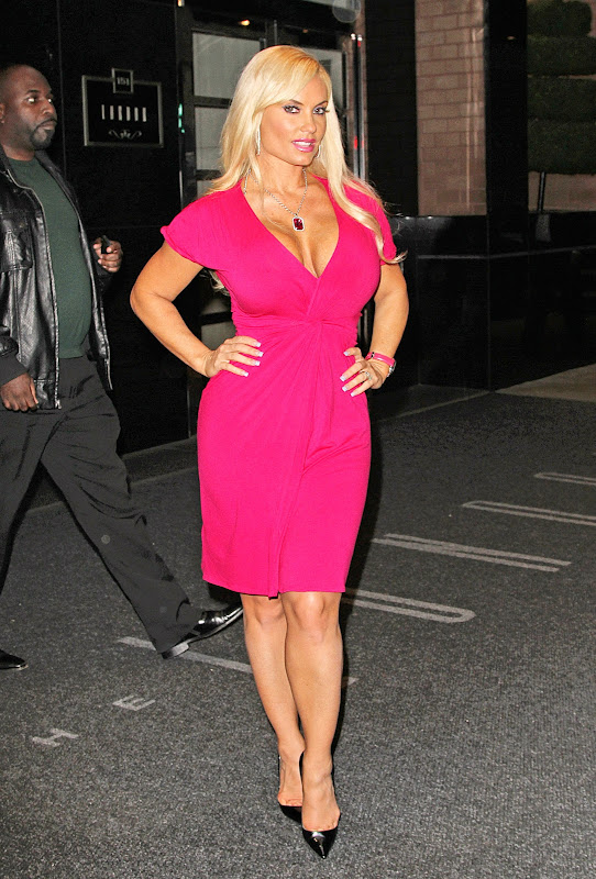 Coco Austin looking hot in a pink dress