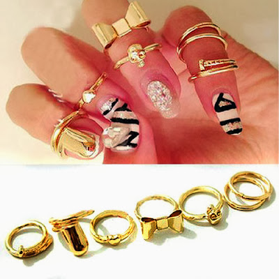 http://www.ebay.co.uk/itm/SET-Knuckle-Heart-Bowknot-Skull-Plain-Band-Nail-Midi-Finger-Ring-Top-Stacking-UK-/111191300913?pt=UK_JewelleryWatches_WomensJewellery_Rings_SR&var=&hash=item19e3849b31
