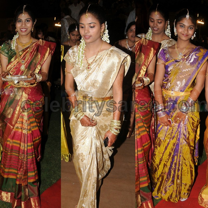 Middle: Off white uppada silk traditional saree with printed work