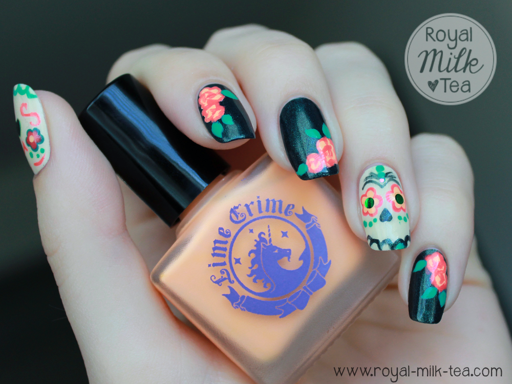 Royal milk tea dia de los muertos sugar skull nail art well i eventually figured out what id do and came up with this i painted calaverassugar skulls on my thumb and ring finger and bunches of marigolds on prinsesfo Gallery