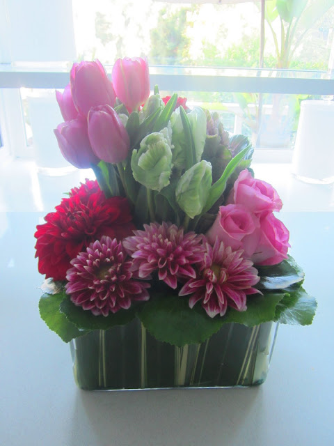 flower arrangement with pink tulips and roses and other red and pink flowers