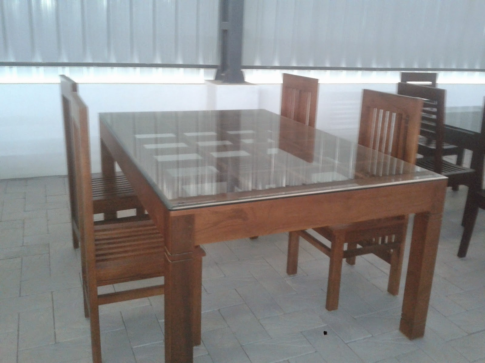 Kerala style carpenter works and designs december 2014 for Dining table latest model