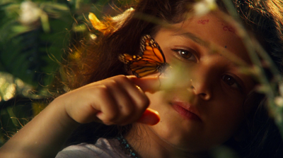 Michael Jackson's – This is it – The Earth Song, a butterfly on an innocent hand in the forest.