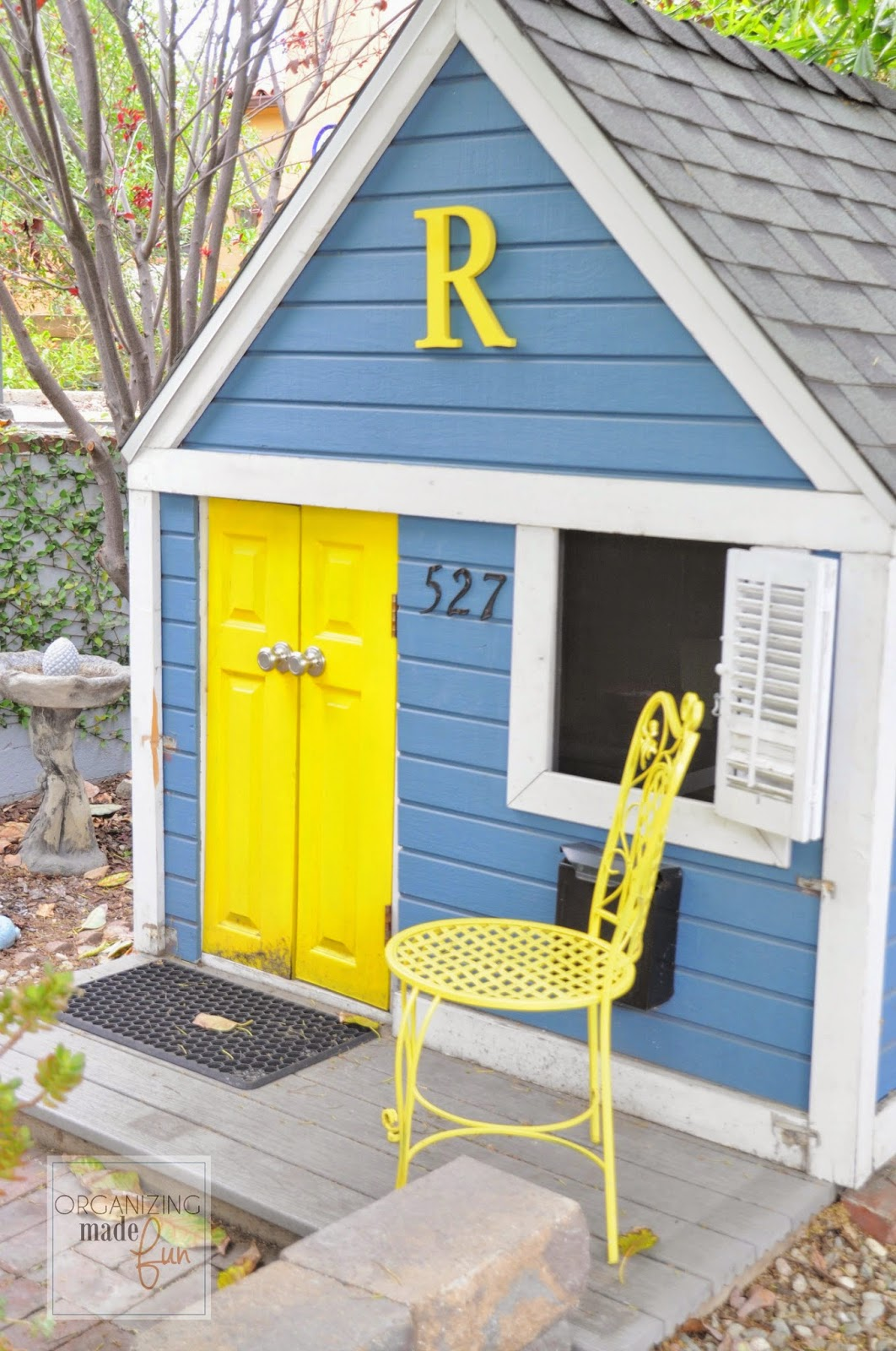 Outside playhouse in blue and yellow :: OrganizingMadeFun.com