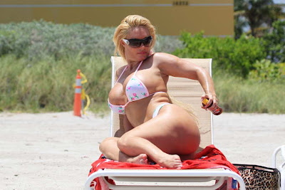 Nicole Coco Austin in pink bikini at beach