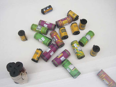 Multi-colored film canisters casually arrayed in a case