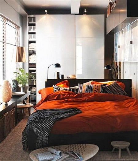 modern black and white and orange bedroom