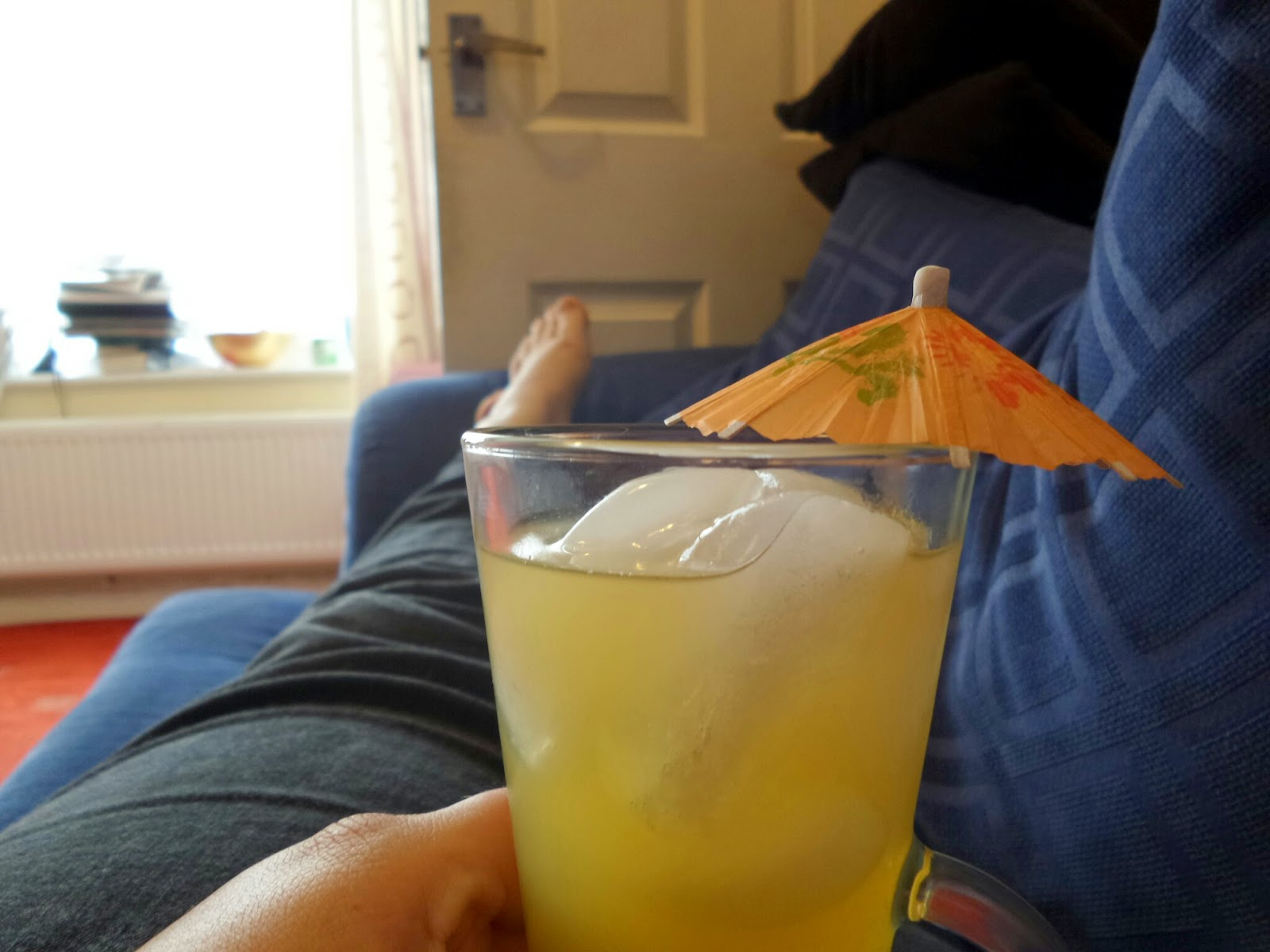The Cracker Drinks Co Pineapple, Coconut & Lime Drink in a glass