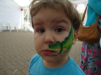 Big Boy with a dinosaur face paint