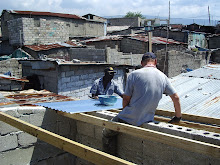 Cite Soleil, Haiti 2011: Replacing the roof on a rebuilt home