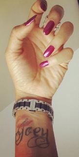 Adaeze Yobo tattoos son's name on her wrist