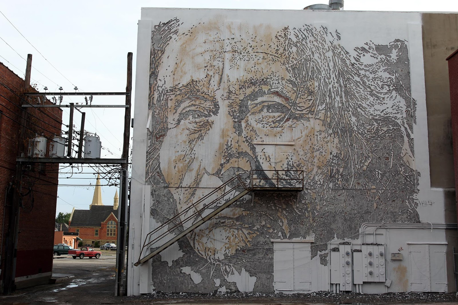 Nice Unexpected u Vhils unveils a new mural in Fort Smith Arkansas