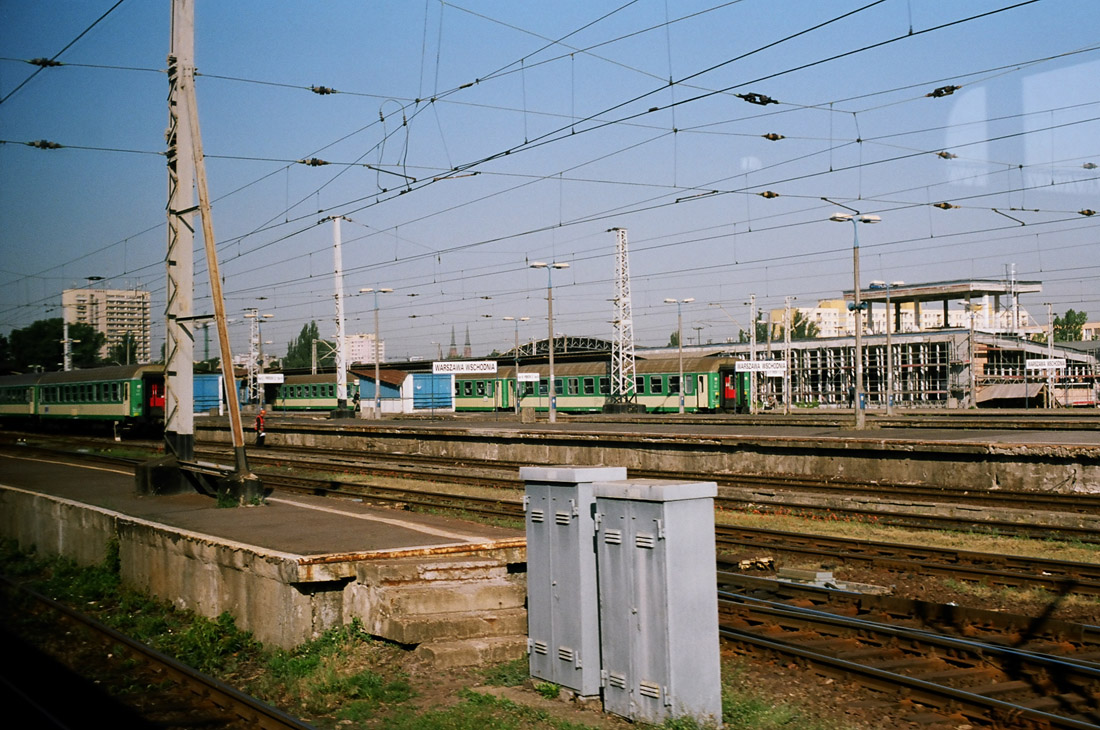 rough charm of the warszawa wschodnia station milieu as seen from the accelerating eastbound train