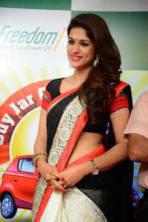 Shraddha Das in lovely Designer Saree with Lace Border at Freedom Buy Jar Get Car offer Launch