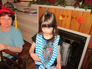 Curly wearing a new blue striped shirt and Mama still in the cap and tassel