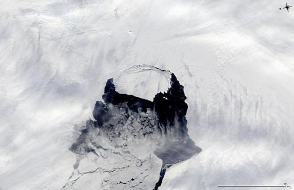 An iceberg which was part of the Pine Island Glacier is shown separating from the Antarctica continent in this MODIS image taken by NASA's Aqua satellite on November 10, 2013 and released by NASA November 14, 2013. (Credit: reuters/nasa/handout via Reuters) Click to enlarge.