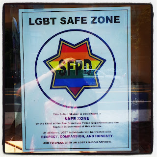 Sign in Police Station window, advertising it as a LGBT Safe zone