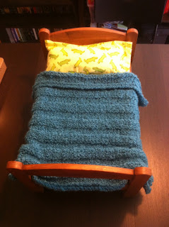 knit doll blanket on bed