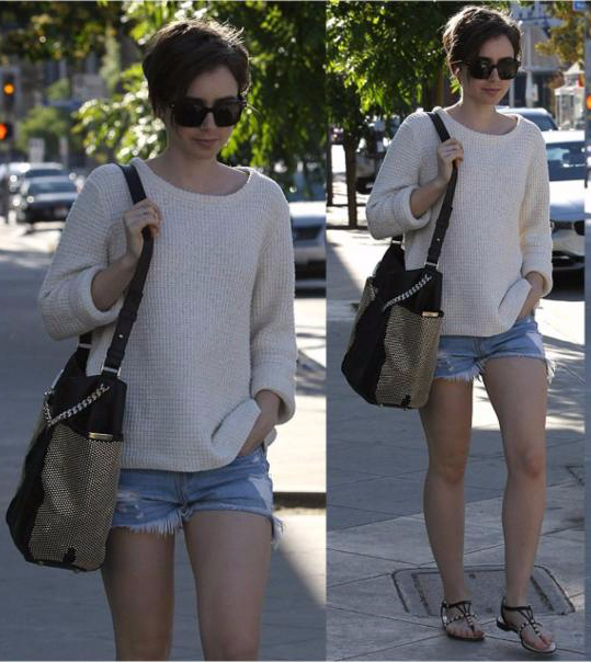 Lily Collins Ripped Jean Shorts
