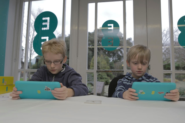 children reviewing the Robin tablet from EE