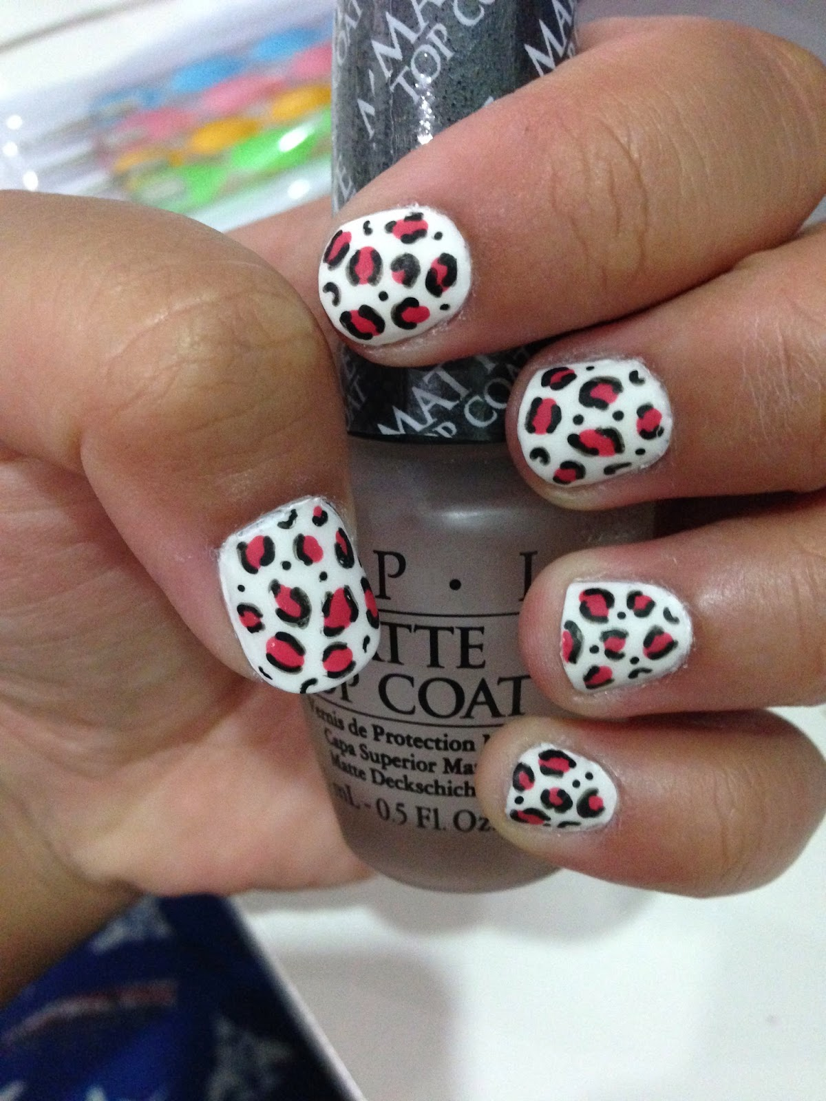 OPI matte top coat on abstract leopard print design