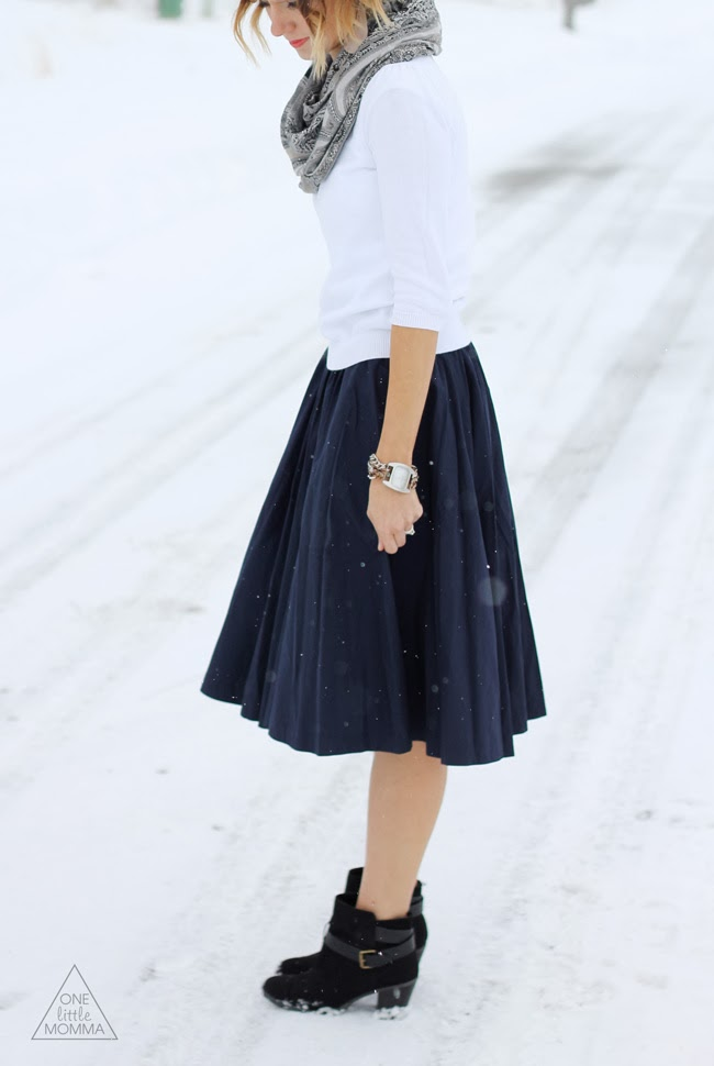 Full navy midi skirt paired with black ankle boots and sweater