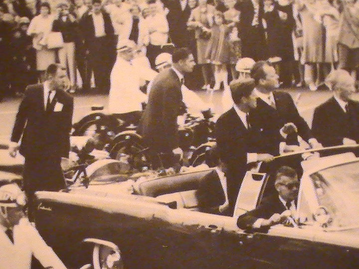AGENT GERALD BLAINE ON THE REAR OF JFK'S LIMO